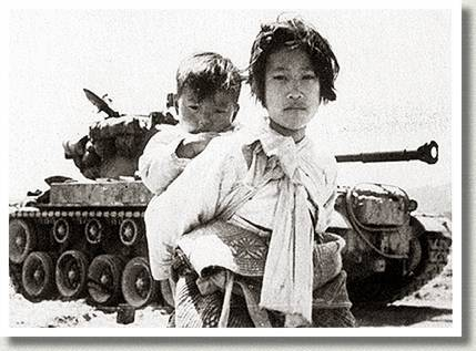 Korean Girl and Her Brother Pass by a Stalled American M-26 Tank, Haengju, Korea, 9 June 1951.